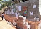 MORADORES DA VILA AMÉLIA NÃO ACEITAM CONSTRUÇÃO DE MURO NA LINHA FÉRREA VITORIA MINAS